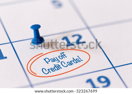 The words Pay off Credit Cards written on a Calendar - stock photo