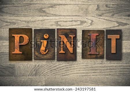 """The words """"PIN IT"""" written in wooden letterpress type. - stock photo"""
