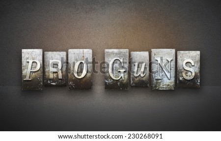The words PRO GUNS written in vintage letterpress type - stock photo