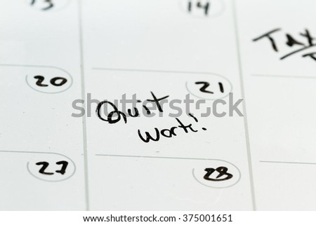 the words quit work hand written on a dry erase calendar as a concept - stock photo