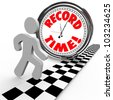 The words Record Time on a clock with a person reaching the finish line to achieve or accomplish a new personal best timing in completing a race or objective - stock photo
