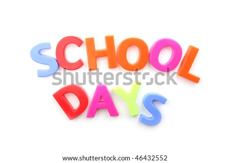The words 'school days' spelled out using colored fridge magnets, isolated on white