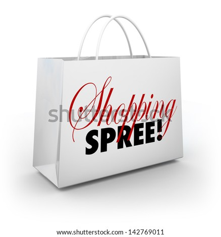 The words Shopping Spree on a white bag for carrying your merchandise at a store or mall as you spend money on goods and products - stock photo