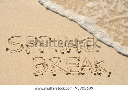 The Words Spring Break Written in the Sand on a Beach - stock photo