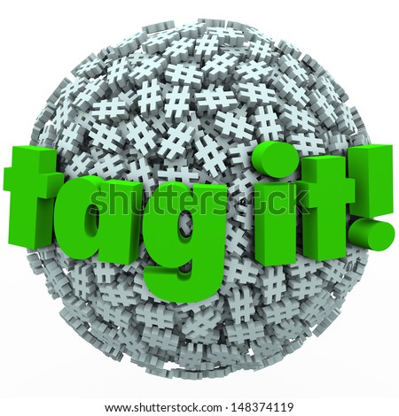 The words Tag It on a ball or sphere of hash tags to illustrate trending topics, posts or stories promoted with hashtags on news sites or social networks - stock photo