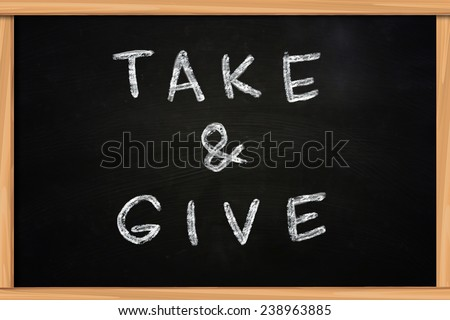 The words Take and Give written with chalk on blackboard