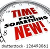 The words Time for Something New on a clock showing need for change, upgrade or update to modern choice - stock photo