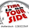 The words Time is On Your Side, a saying on a clock to illustrate that you are making good time and you have a surplus and excess of opportunity to get a job or task done to successful conclusion - stock photo
