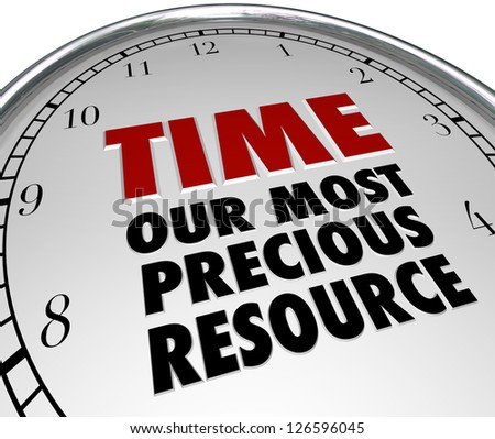 The words Time - Our Most Precious Resource on the white face of a clock, pointing out that time is the most valuable commodity in our lives and once it is gone it is lost forever - stock photo