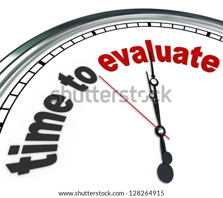 The words Time to Evaluate on an ornate white clock, counting down to the moment a manager will perform an evaluation, review, assessment or reevaluation of a worker, property or process - stock photo