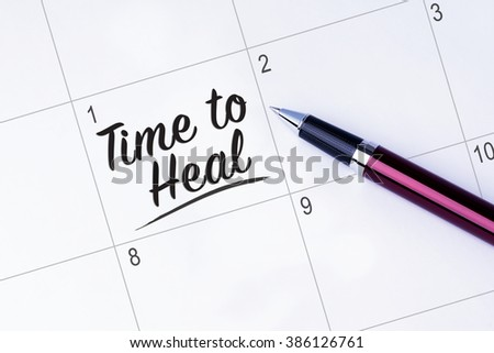 The words Time to Heal written on a calendar planner to remind you an important appointment with a pen on isolated white background.  - stock photo