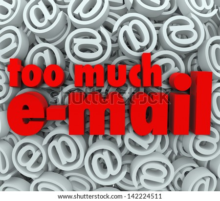The words Too Much E-Mail on a background of email at symbols and signs to illustrate being flooded with unwanted messages or spam in your mail inbox - stock photo