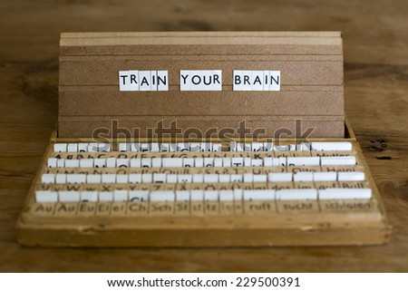 "the words ""train your brain"" on an old school letter box"
