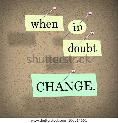 The words When in Doubt Change pinned to a cork bulletin board representing self-help improvement advice to motivate you to make positive changes in your life for success - stock photo