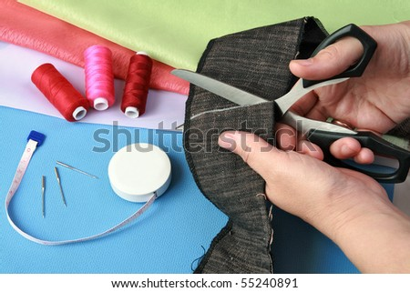 The work of cutting a piece of cloth - stock photo