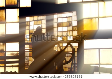 the worker and the window - stock photo