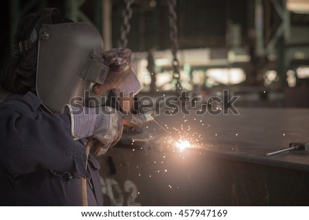 The worker are wedding steel, Industry background.