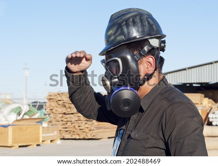 The worker dressed a gas mask, examines a chemical production site - stock photo