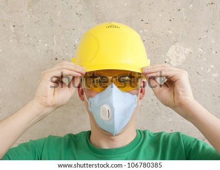 The worker in protective means. Headshot of a worker in protective workwear - stock photo