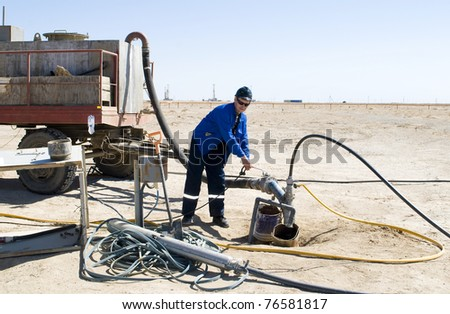 The worker serves a chink for extraction of natural uranium - stock photo