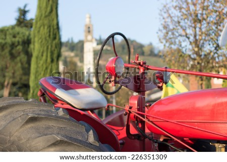 the workforce of the tractor that helps people in the country for a long time  - stock photo
