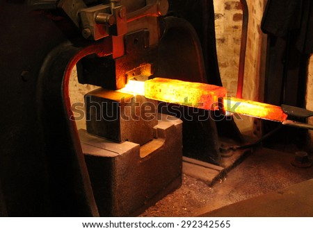 The Working of Red Hot Metal in a Large Foundry Forge.