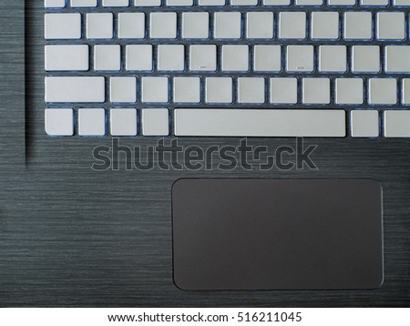 the working surface of the laptop.keys and trackpad closeup.