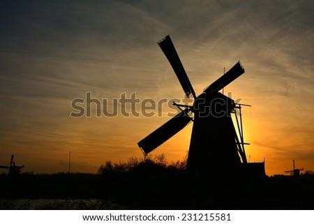 The world Heritage Kinderdijk windmill landscape at dusk, the Netherlands. - stock photo