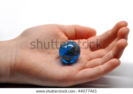 the world in the palm of a childs hand - stock photo
