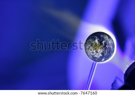The World is super blower representing Global warming - stock photo