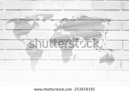 the world map on the wall , The outside world has a lot Do not cover yourself with a wall. Destroy it and went into the world. - stock photo