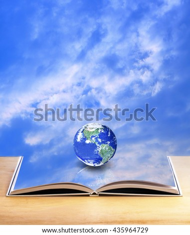 The world on open book with sky background, imagination is the key to open up the world concept, Elements of this image furnished by NASA  - stock photo
