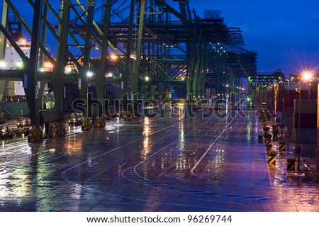 The World's Largest Container Port, Singapore. Heavy rain, cargo operation by night - stock photo