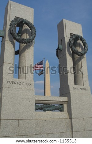 The World War 2 Memorial with the Washington Monument in the background - stock photo