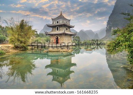 The wrenching  tower in guangxi, China. - stock photo