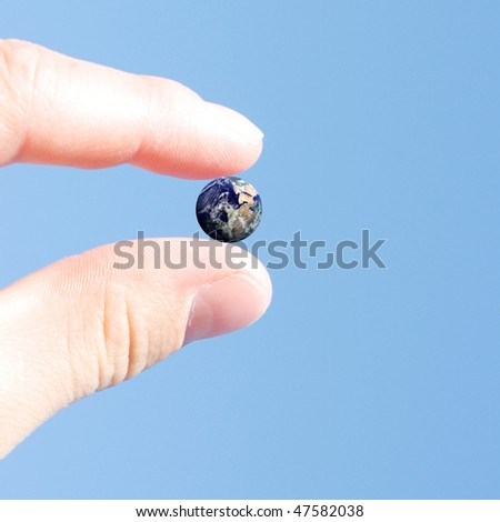 The wrld between your fingers - stock photo