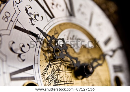 The X hour An old-style pendulum clock face with focus on the hour hand pointing to X or 10 - stock photo