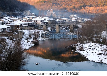 The Yantra river and Asenov district of Veliko Tarnovo in Bulgaria in the winter - stock photo