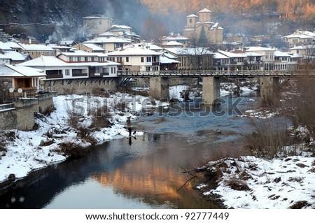 The Yantra river and Asenov district of Veliko Tarnovo in Bulgaria in the winter - stock photo