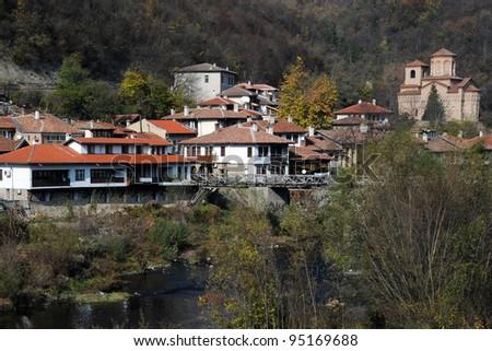 The Yantra river, residential neighborhood and Saint Dimitri church of Asenov district in Veliko Tarnovo in Bulgaria in the fall - stock photo