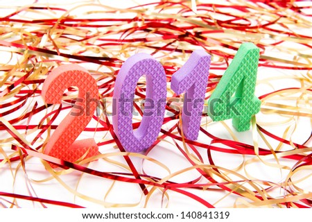 The year 2014 in colorful children's foam letters on angle shown on white background for new year with colourful streamers surrounding them - stock photo