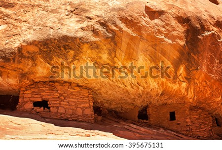 The 800 year old Anasazi ruins of Mule Canyon, known as The House of Fire, because when the sun hits the rock, it appears to glow as if on fire. Cedar Mesa, Utah, USA - stock photo