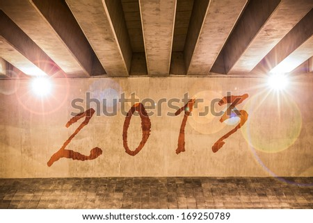 The year 2013 painted as graffiti on the support column of an overpass - stock photo