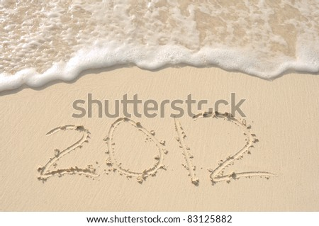 The Year 2012 Written in the Sand on a Beach - stock photo