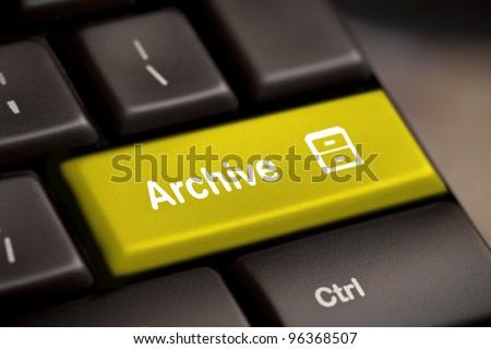 the yellow archive enter button key - stock photo