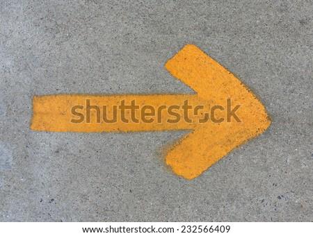 The Yellow arrow on floor street background - stock photo