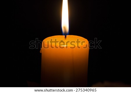 The Yellow  candle in the dark room for background or your text - stock photo
