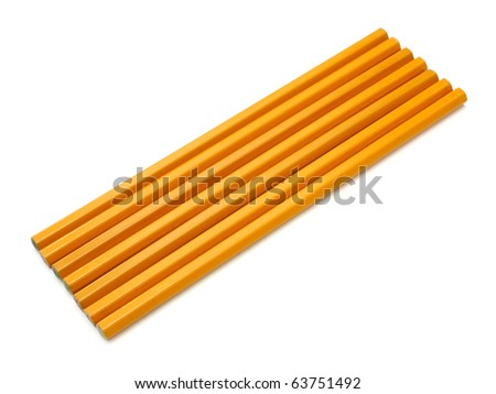 The yellow ground pencil lies is isolated on a snow-white background