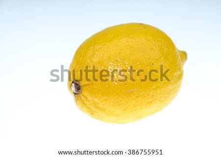 The yellow lemon on a white background is isolated