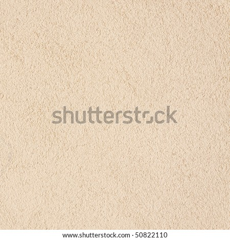 The yellow plastered wall with fine texture - stock photo